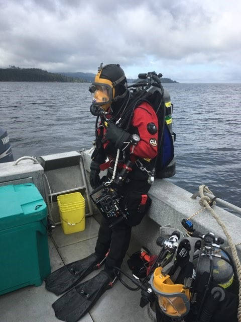 A diver on the boat geared up for surveys.