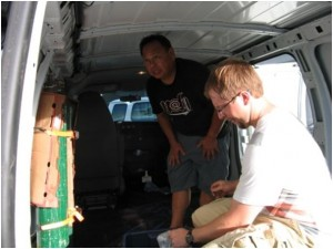 Alan and Bryan installing oxygen tanks