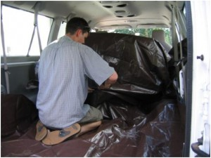 Andy putting tarps down in the van