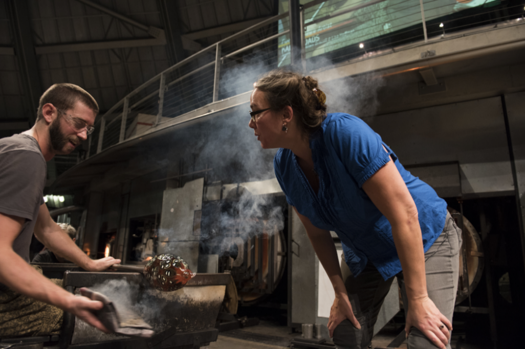 Kait Rhoads, right, with Hot Shop Manager and Gaffer Ben Cobb in the Museum of Glass Hot Shop. Photo: Rozarii Lynch.
