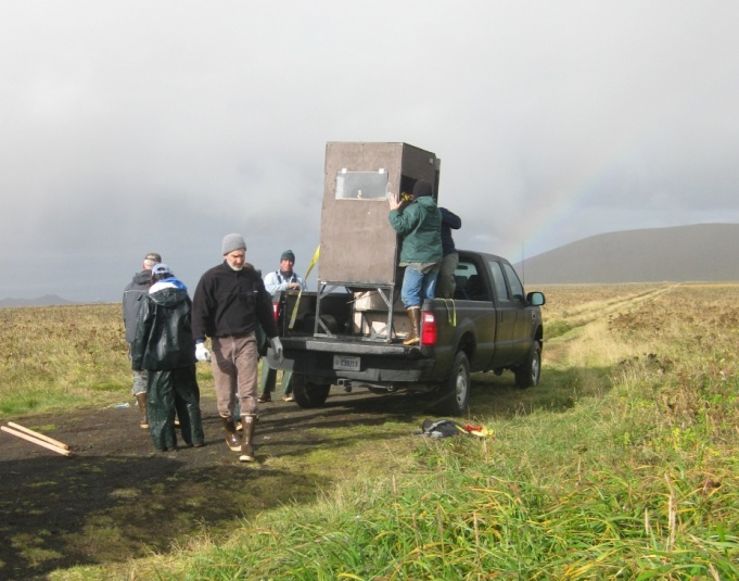 The crew loading up an observation blind for the winter. Complete with rainbow.