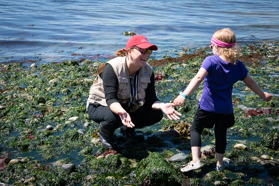 Fellow beach naturalist Diana looks for sea critters with an inquisitive young scientist.