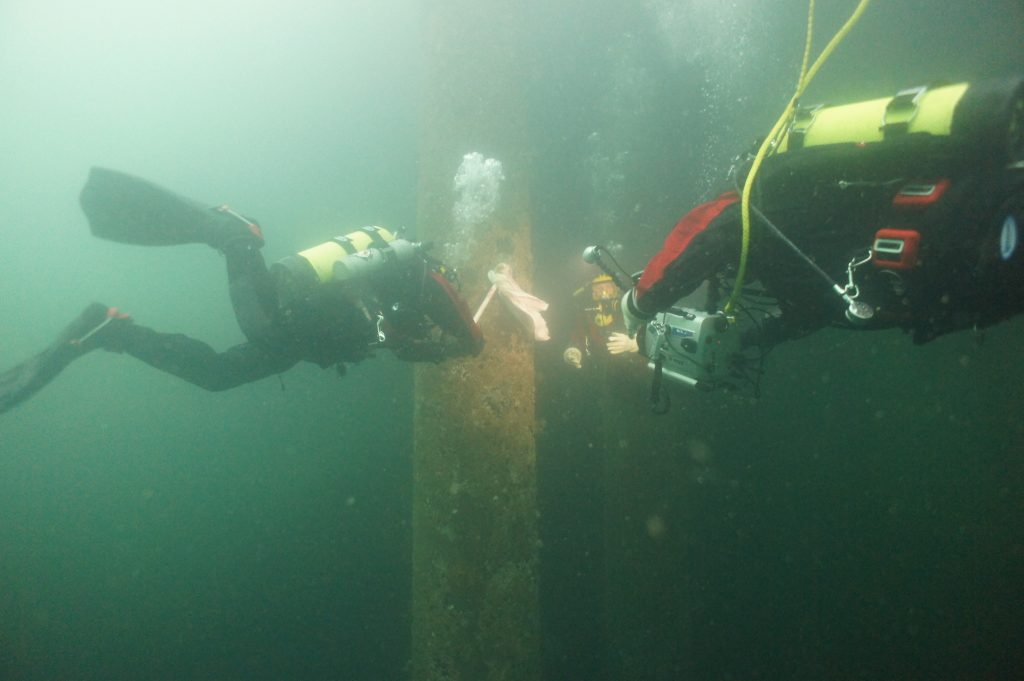 "A ""wet"" rehearsal dive, where Seattle Aquarium divers rehearse the octopus release using a ""moptopus""."