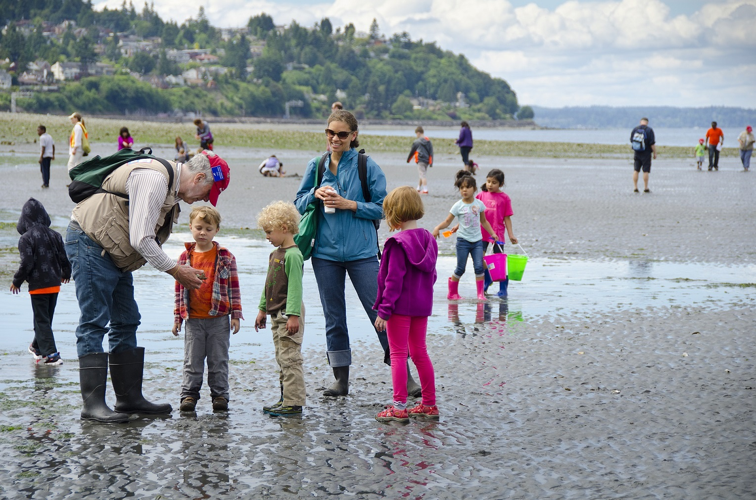 Beach naturalists on local Seattle beach speaking to visitors