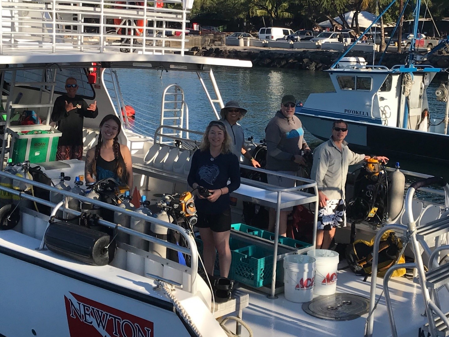 Crew on Kohala Divers boat going out to survey sites 1, 2 and 5, all near Puako.