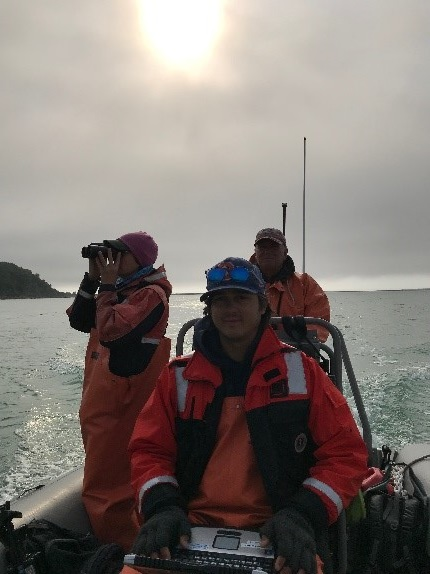 Heather, Jim and Brian U. on a early morning marine bird and mammal survey in Swikshak Bay.