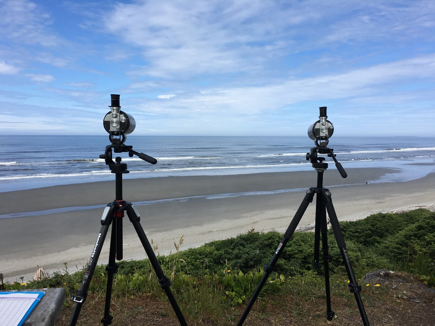 Two scopes set up near a beach