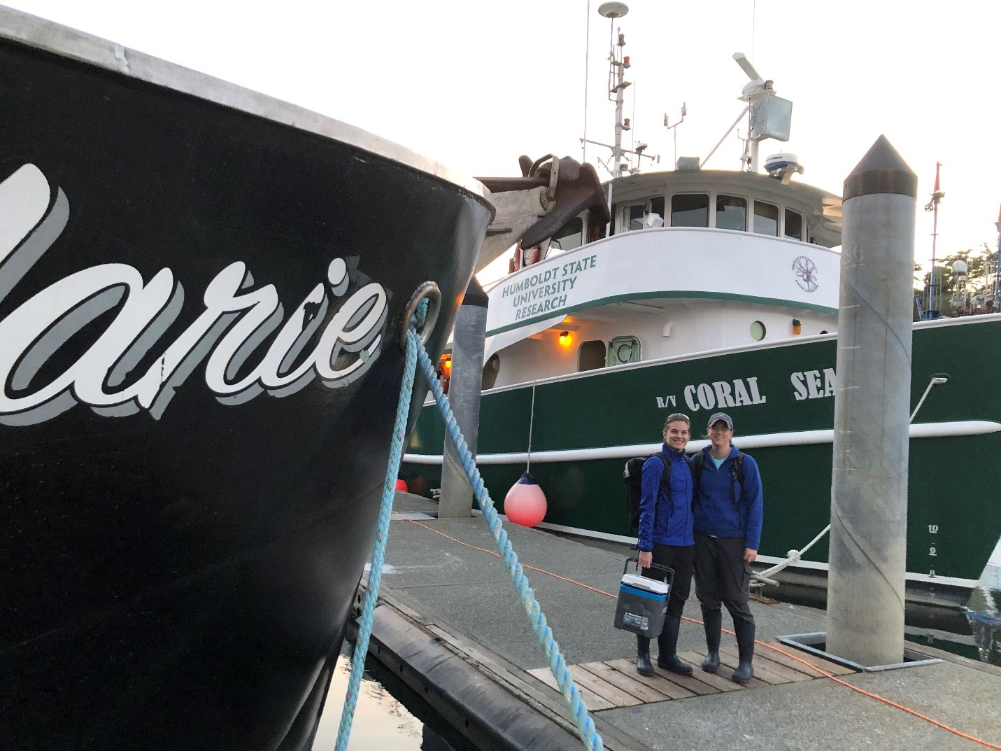 Sara Perry and Cheryl Becker in front of the research vessel prior to a night of marbled murrelet tagging.