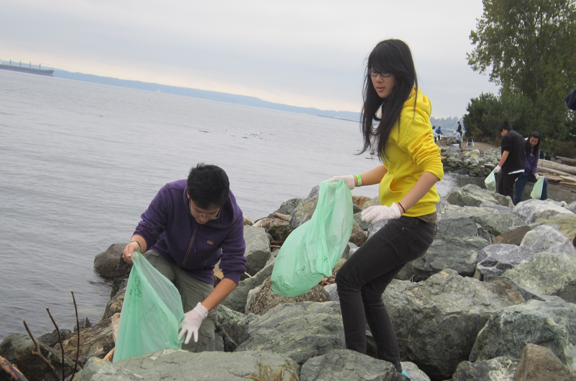 Teens clean plastic off the beach