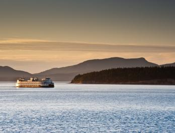 Ferry boat on Puget Sound at sunset